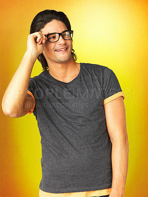 Buy stock photo Attractive man adjusting glasses on face