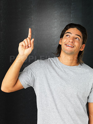Buy stock photo Handsome man pointing up
