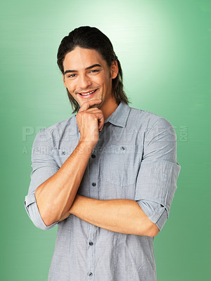 Buy stock photo Attractive man posing with hand on chin
