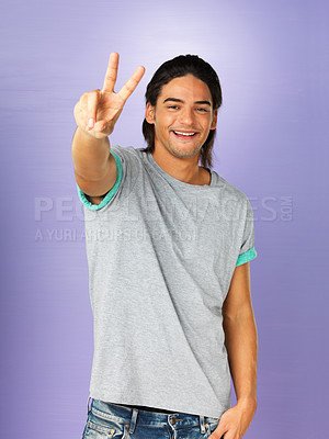 Buy stock photo Handsome man giving peace sign