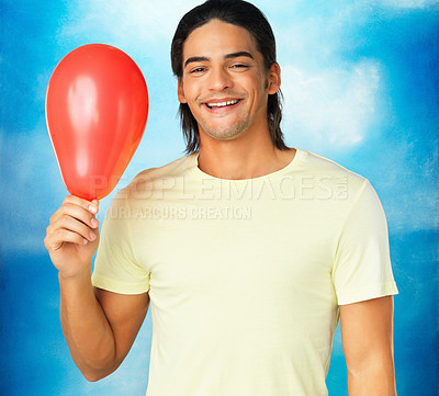 Buy stock photo Closeup of happy young man holding red balloon