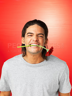 Buy stock photo Young man holding yellow flower in his mouth