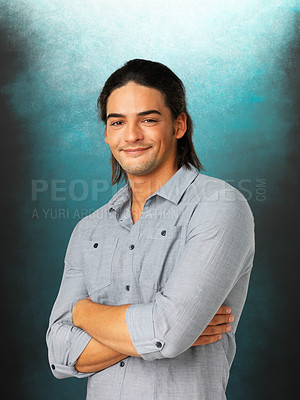 Buy stock photo Portrait of smiling man standing with arms crossed