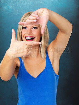 Buy stock photo Smiling beautiful woman looking through a frame created with her hands