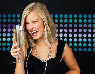 Buy stock photo Closeup of joyful woman holding champagne flute