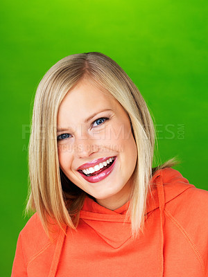 Buy stock photo Closeup portrait of smiling woman on green background