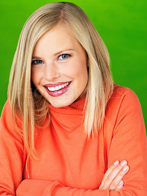 Buy stock photo Closeup of pretty woman with arms folded on green background