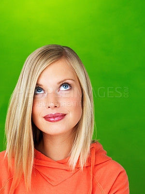 Buy stock photo Beautiful woman looking up on green background