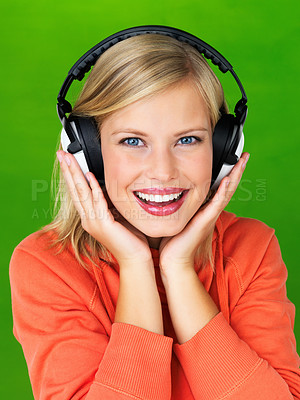 Buy stock photo Closeup portrait of smiling woman with headphones on green background