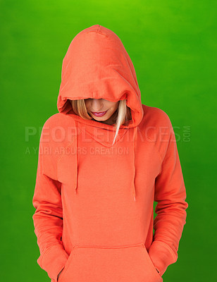 Buy stock photo Portrait of young woman in orange sweatshirt with hood