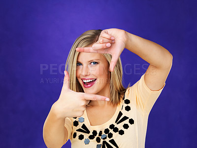 Buy stock photo Smiling woman looking through a square frame shaped with her hands