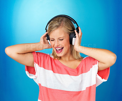 Buy stock photo Pretty woman singing while listening to headphones