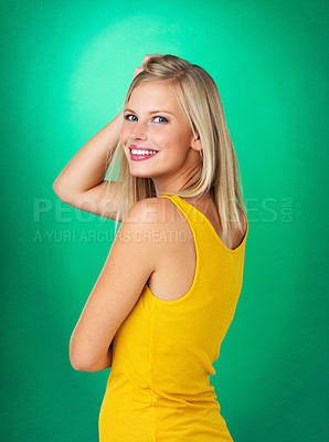 Buy stock photo Side view of woman with hand in her hair and smiling