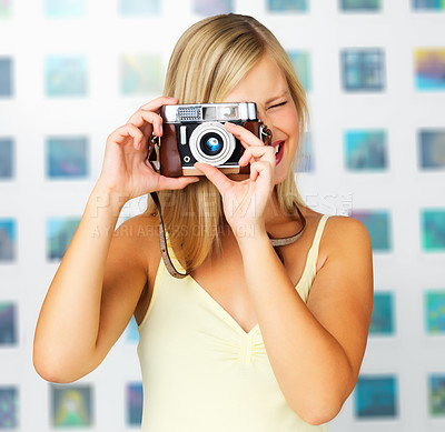 Buy stock photo Woman focusing lens on vintage camera and about to take your picture