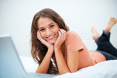 Buy stock photo Smiling girl taking a break from working on her laptop