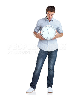 Buy stock photo Portrait of a handsome young man holding a clock in hand over white background