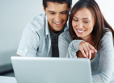 Buy stock photo Portarit of a beautiful young couple working together on laptop