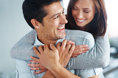 Buy stock photo Closeup portrait of a pretty young woman hugging her boyfriend from behind
