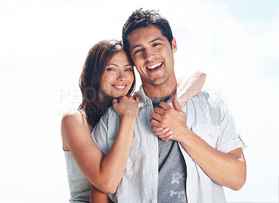 Buy stock photo Portrait of a romantic young couple standing together - Outdoor
