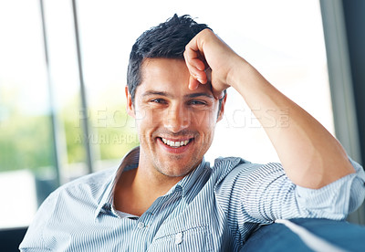 Buy stock photo Portrait of an attractive young man looking at you with a smile