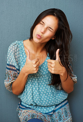Buy stock photo Woman puckering mouth while giving two thumbs up