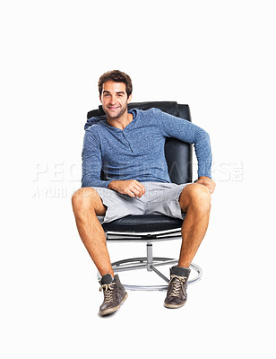 Buy stock photo Trendy young man sitting comfortably on chair against white background