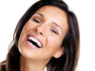 Buy stock photo Closeup portrait of an excited young female laughing against white background