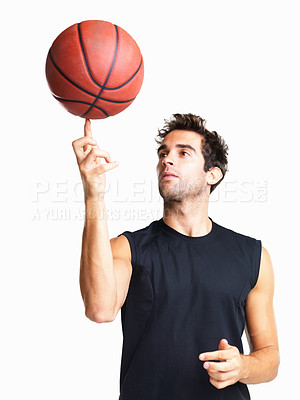 Buy stock photo Basketball player spinning ball on his finger