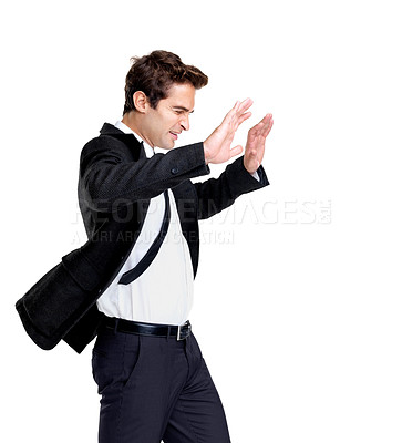 Buy stock photo Portrait of a young business man fighting against wind on white background