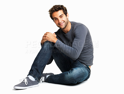 Buy stock photo Young casual man smiling while sitting on the floor