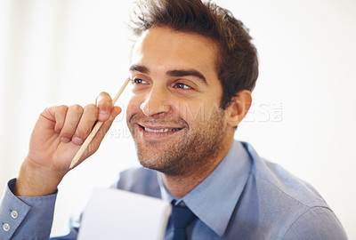 Buy stock photo Happy business man holding pencil in hand and looking away