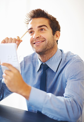 Buy stock photo Smiling young executive holding pencil and notepad looking up