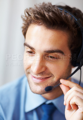Buy stock photo Closeup portrait of smiling young consumer consultant with headset looking away and smiling