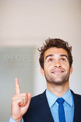 Buy stock photo Executive pointing and looking upwards