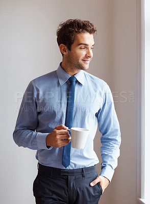Buy stock photo Executive casually standing next to window with cup of coffee