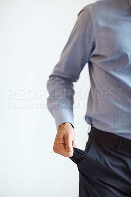 Buy stock photo Businessman holding out pocket