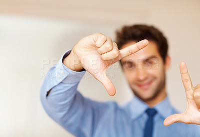 Buy stock photo Focus a framed that a young business executive is making with his hands