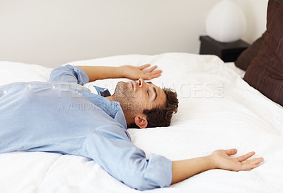 Buy stock photo Man resting on his back with eyes closed