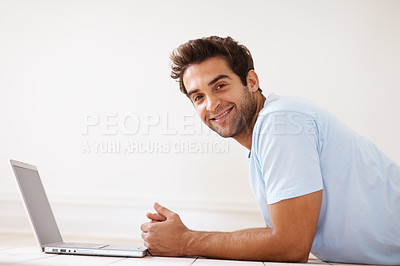 Buy stock photo Side view of man lying on floor next to laptop