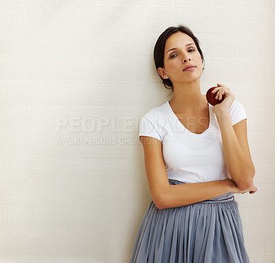 Buy stock photo Pretty young woman holding a red fresh apple standing against white background - Ocpyspace