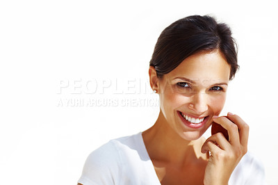 Buy stock photo Portrait of cheerful young woman holding a red apple and smiling isolated against white background
