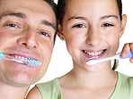 Oral hygiene -  Sweet girl brushing with her father