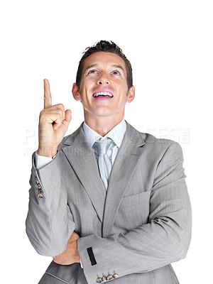 Buy stock photo Portrait of a happy young male business executive pointing upwards at copyspace against white background