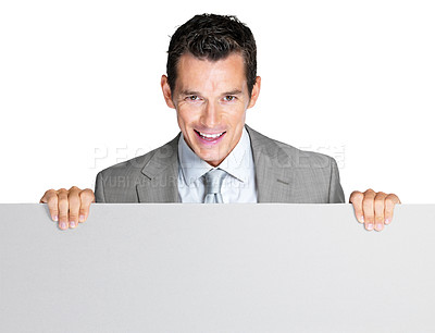 Buy stock photo Portrait of a happy young male entrepreneur holding an empty billboard against white background
