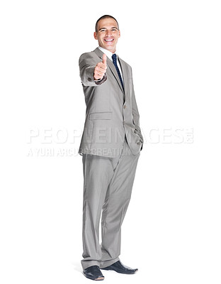 Buy stock photo Portrait of a confident young male business executive showing thumbs up sign against white background