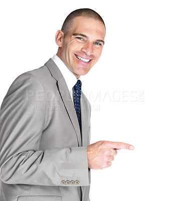Buy stock photo Portrait of a handsome young male entrepreneur pointing at something interesting against white background