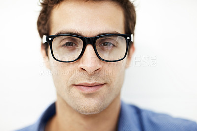 Buy stock photo Closeup portrait of smart young man wearing glasses against white background