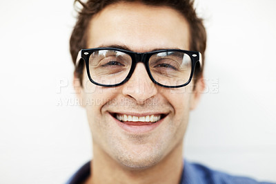 Buy stock photo Closeup of smiling young man wearing glasses on white background