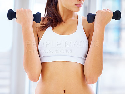 Buy stock photo Cropped image of beautiful young female working out with free weights