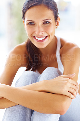 Buy stock photo Portrait of pretty young woman sitting hugging legs